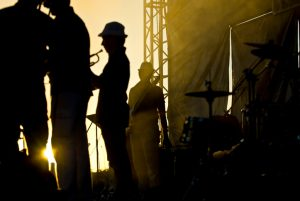 Silhouette of few musicians, staying at stage