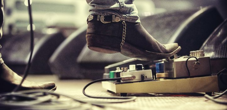 Cropped shot of a music artist's foot on a foot pedal. This concert was created for the sole purpose of this photo shoot, featuring 300 models and 3 live bands. All people in this shoot are model released.http://195.154.178.81/DATA/i_collage/pi/shoots/782610.jpg